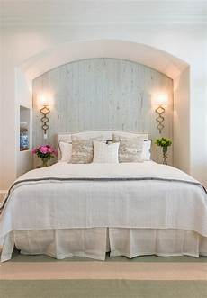 arched bed nook with plank backsplash cottage bedroom