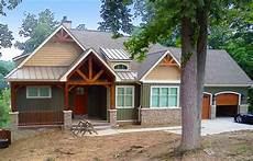 sloping house plans rugged craftsman home for a sloping lot 17650lv