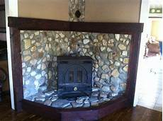 river rock stove surround and mantel project complete stove surround stove