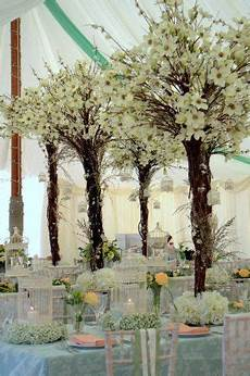 styling of a traditional marquee using flower trees from essential wedding hire chair