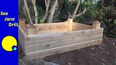 build a raised garden bed in less than an hour on a budget