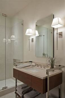 modern interior design and modern bathroom lighting ideas with wall sconces in both sides of