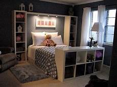 comfortable bedroom in dark colors and shelves in the interior kallax ikea interior bedroom