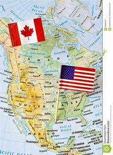 canada and usa flag pin on map stock image image of grid