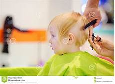 cute little boy getting his first haircut stock image