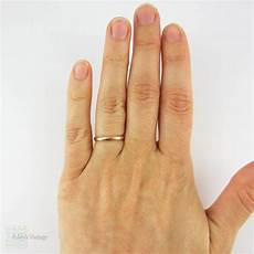 22 carat gold wedding ring narrow yellow gold band in light court fit fully