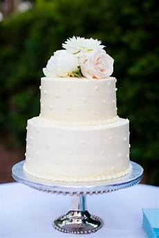 two tier polka dot buttercream wedding cake