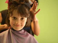 a 6 year old girl gets a haircut photographic print by stephen alvarez at art com