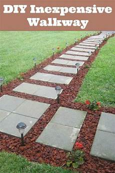 front walkway built out of inexpensive cement pavers