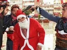 turkish muslim nationalists put gun to santa s to