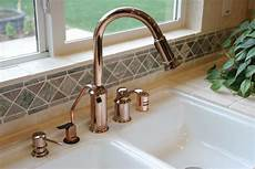pictures of kitchen sinks and faucets how to install a kitchen soap dispenser