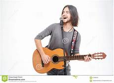 guitar and singing handsome musician guitar singing a song royalty free stock photo cartoondealer