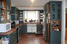 we are thinking of painting the cabinets navy or black