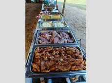 Buffet for a country wedding under and open barn. Herb