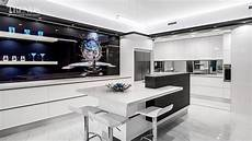 sleek contemporary entertainers kitchen with separate scullery and decorative waterdrop