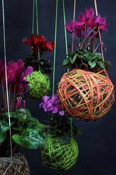 Indooroutdoor Hanging Moss Balls Filled With Plants moss hanging plants by mister moss design milk