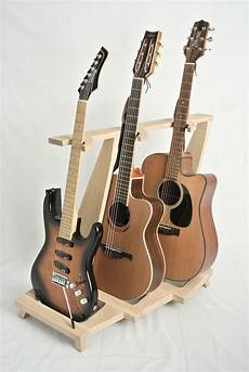 Guitar Stand Made Of Wood With Three Guitars Pied De