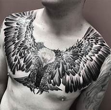 flying eagle with talons ready mens chest tattoo