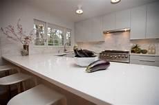 Marbre De Cuisine White Quartz Countertops Set On Wooden Kitchen Furniture