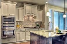 sherwin williams snowbound painted cabinets make the kitchen feel bigger and elegant kitchen