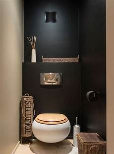 toilette original deco idee deco wc sobre et zen avec murs noir et beige et