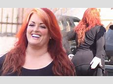 Wynonna Judd slaps her rear end as she prepares for