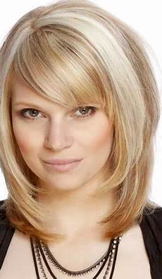 15 pics of medium length hairstyles with bangs and layers