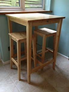 ikea bar table and two matching stools in solid birch wood
