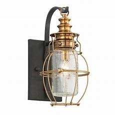 outdoor wall light with clear cage shade in aged brass forged black finish b3571