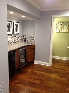 sherwin williams krypton with artificial light basement and cherry cabinets paint colors