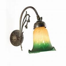 victorian or edwardian single wall light aged brass green shade