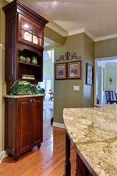 love the green paint with the cherry cabinets will you