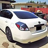 Nissan Altima Pearl White Black Emblems  Materialistic