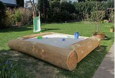 sandkasten aus baumstämmen bauen robinie und l 228 rche sandk 228 sten prisga spielger 228 te gbr