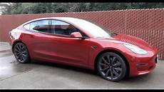 tesla model 3 gray chrome tesla model 3 chrome delete with red handles and turbine