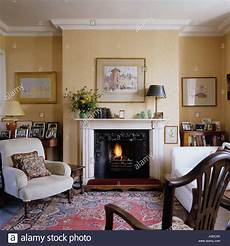 country style living room with mantel arm