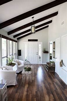 white walls and in floor storage make this creative house design wood floors and white walls with wood on ceiling
