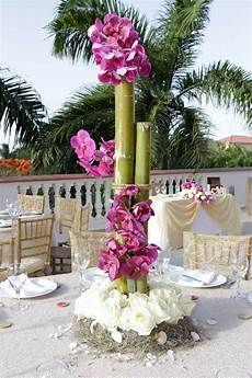 bamboo and orchids make for such unique and tall centerpieces for your destination wedding at