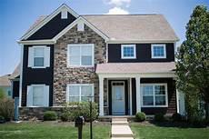 modern exterior house painting upgrade dark gray siding with white trim