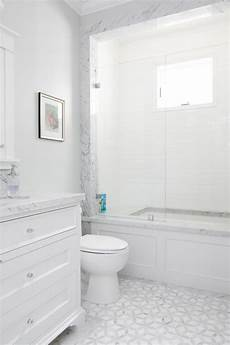 white bathroom floor tile ideas this white bathroom features a unique white and gray tile pattern a slab counter top and