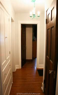 painted hallway trim white house black shutters
