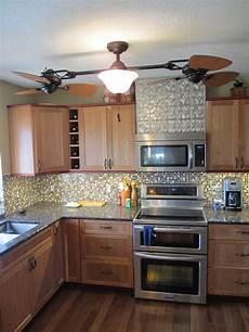 a kitchen remodel 7 tile backsplash and faux textured tin