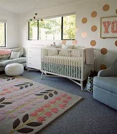 use area rugs over carpeting to add color and pattern to a