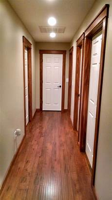 white painted doors with stained wood trim rustic cozy