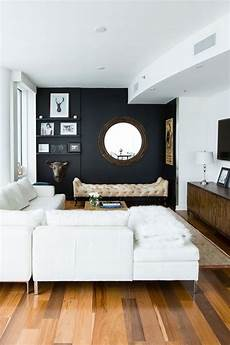 Home Decor Ideas For Living Room With Black Sofa by 26 Gorgeous Living Rooms With Black Walls Digsdigs