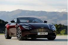 aston martin db11 looks divine in deep wine red carscoops com