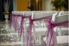detail shot of the chair decorations with ribbons falls
