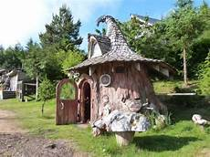 an innovative house carved out of a tiny hobbit home carved from a stump is out of a