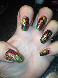rasta inspired foil nail art design with hand painted