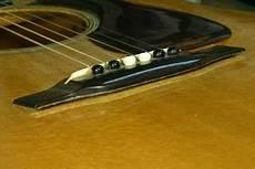 how to fix a guitar bridge frets